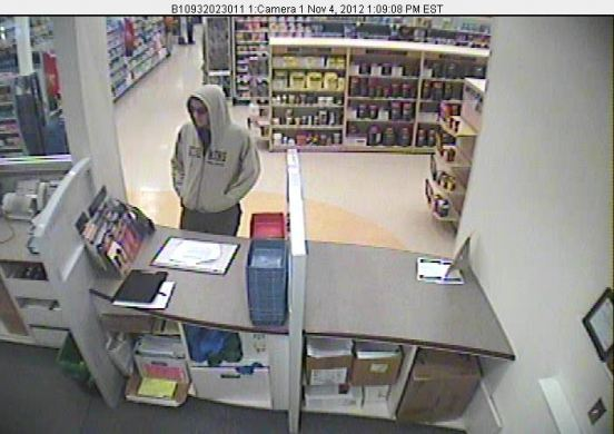 This surveillance video image, distributed Monday afternoon by the Cumberland County Sheriff's Office, depicts a man who deputies say robbed a Rite Aid pharmacy in Gray on Sunday. Investigators are asking the public to help identify the suspect.