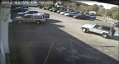 This surveillance video image, distributed Monday afternoon by the Cumberland County Sheriff's Office, depicts a Jeep Wrangler deputies say a man used in robbing a Rite Aid pharmacy in Gray on Sunday. Investigators are asking the public to help identify the vehicle.