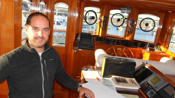 Andreu Balcells in the wheelhouse of the Atlantide, a 122-foot motor yacht that once rescued Allied troops from Dunkirk, France during World War II. Balcells is overseeing the vessel's visit to Belfast's Front Street Shipyard, where it is undergoing work.