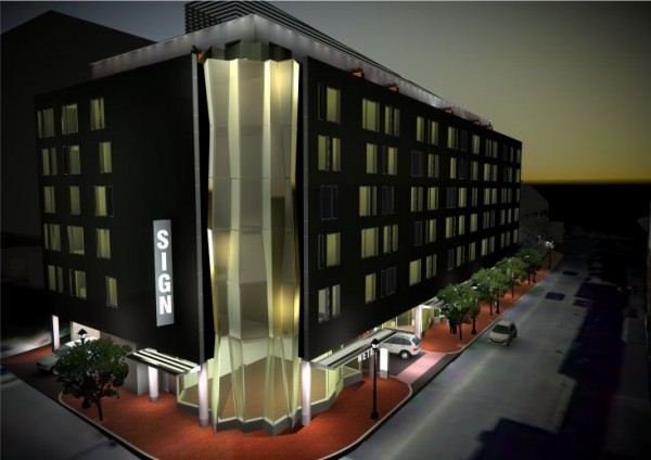 This image, released by property management and development firm East Brown Cow, depicts how the group's proposed Canal Plaza Hotel would appear on Portland's Fore Street at night.