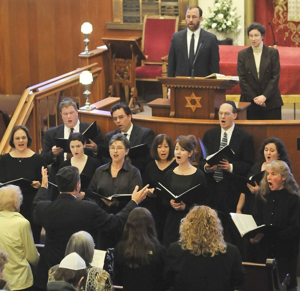The choir from Rockland-based Adas Yoshuron Synagogue, with director Dana Goldsmith, performs the national anthem of Israel Sunday, April 19, 2009, at Congregation Beth Israel in Bangor.