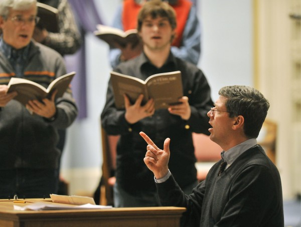 Dr. Kevin Birch (right), music director at St. John Catholic Church in Bangor, directs the Chamber Choir of St. John's Parish as it rehearse sacred Lenten music by Buxtehude on Saturday, March 23, 2009.