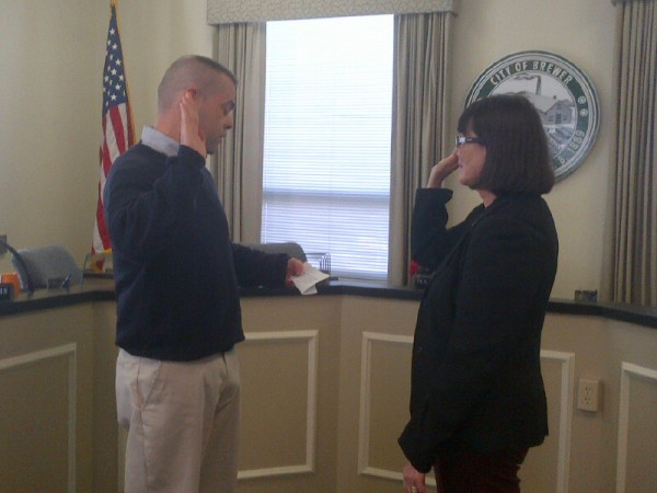 Exiting Brewer City Clerk Howard Kroll conducts the swearing in ceremony for his replacement, Pam Ryan, on Friday, Nov. 16, 2012.