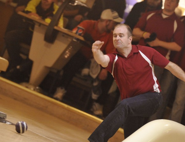 Tony MacLaughlin of MacLaughlin Trucking from Nova Scotia, Canada  bowls in the first round of the playoffs on Friday afternoon, Nov. 9, 2012 against Fenway Painters at Bangor-Brewer Bowling Lanes in Brewer.