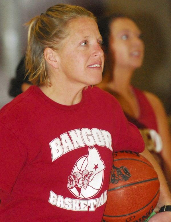 Bangor High School girls basketball coach Katie Herbine watches from the sideline as the players practice at Bangor High School on Monday, Nov. 19, 2012.