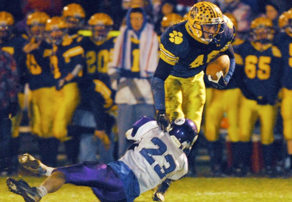 Waterville's Jordan DeRosby (23) tackles Mt. Blue's Chad Luker in the second quarter of the Eastern Maine Class B final at Farmington on Friday night, Nov. 9 2012. Mt. Blue won 42-14.