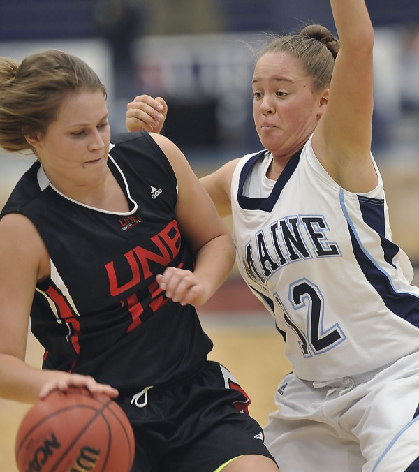 University of Maine freshman Michal Assaf (12) tries to stay in the way of University of New Brunswick forward Claire Colborne (15) in the first half of their exhibition game in Orono on Thursday, Nov. 1, 2012.