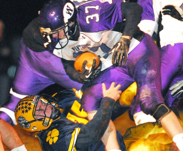 Mt. Blue's Colin Richards (75) takes down Waterville's Cameron Thomas (37) in second-quarter action of the Eastern Maine Class B football final at Farmington Friday night, Nov. 9, 2012. Mt. Blue won 42-14.