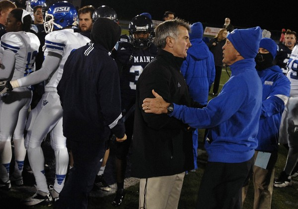 Maine coach Jack Cosgrove (left) and Georgia State coach Bill Curry meet after their game on Nov. 10 at Alfond Stadium in Orono. Cosgrove's contract extension is on hold while he discusses the status of the UMaine football program with athletics director Steve Abbott.