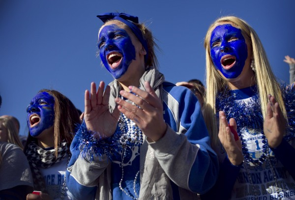 Eighth-graders (from left) Kiana Letourneau, Emma King and Cassidy Quint cheer the Bulldogs at the state championship game Saturday, Nov. 17, 2012, at Fitzpatrick Stadium in Portland.