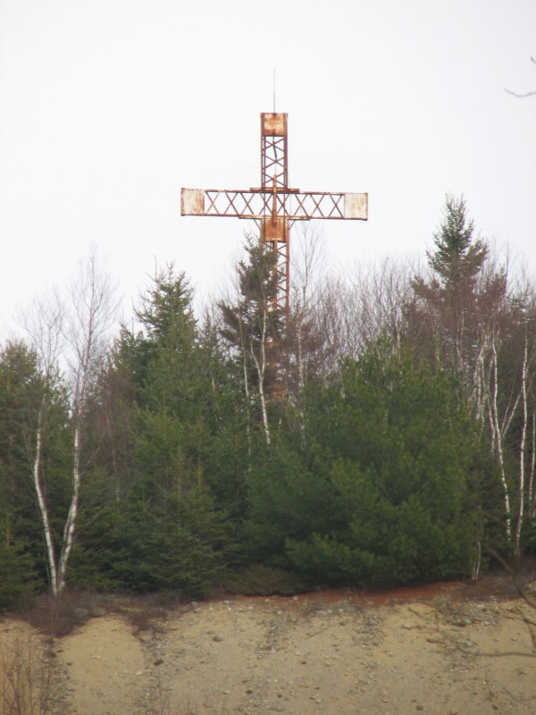 A cross that has stood on a Lamoine hilltop since 1995 likely will be taken down if a construction firm gets approval to expand a 65-acre gravel pit by an additional 45 acres. The resulting 110-acre pit would be one of the largest in the area, according to people involved in the project. The cross, which can be seen from miles around, was erected in protest of a 1990 court ruling that the landowners, Ralph and Mary Miro, had violated local ordinances by mining gravel without a permit.