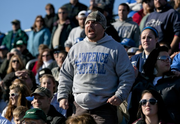 Kevin Guertin, a Lawrence alumnus, cheers the Bulldogs in the state championship game against Thornton Academy on Saturday, Nov. 17, 2012, at Fitzpatrick Stadium in Portland.