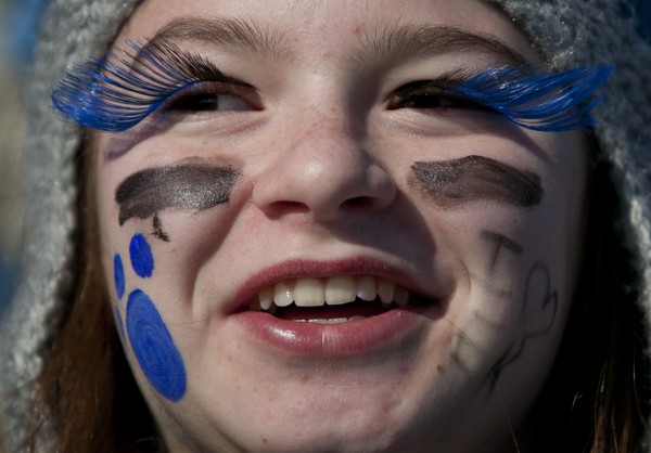 Morgan Boudreau wears Bulldog blue eyelashes made from feathers to show her school spirit on Saturday, Nov. 17, 2012, at Fitzpatrick Stadium in Portland.