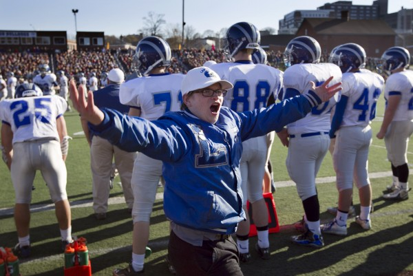 Dennis Brassard, the team's manager, exhorts the crowd to cheer in the fourth quarter of the state championship game Saturday, Nov. 17, 2012, at Fitzpatrick Stadium in Portland.