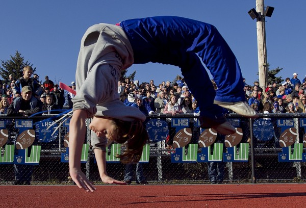 Sophomore cheerleader Mikaela Wyman does a back flip during the state championship game on Saturday, Nov. 17, 2012, at Fitzpatrick Stadium in Portland.
