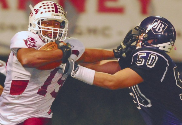 Orono's Norton Revell struggles to break free from John Bapst's  Charles Kindya during first-quarter action in their LTC semifinal at Husson University's Winkin Complex in Bangor on Friday night, Nov. 2, 2012. John Bapst won 30-22.
