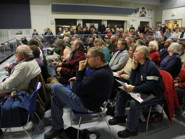 Searsport resident Ben Crimaudo (left) is among the estimated 250 people who crowded into the Searsport District High School cafeteria Thursday night for another evening of public hearings about the proposed liquid propane gas terminal and storage tank project. Crimaudo had been removed from the public hearing on the previous evening.