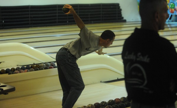 USA East bowler Nate Nealey recorded a 132 average for five games to help his team surge to first place Tuesday after the first day of competition of the World Team Candlepin Bowling Tourney at the Bangor-Brewer Bowling Lanes.