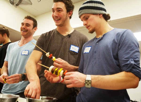 Portland Pirates hockey team members Jordan Szwarz (from left), Philip Lane, and Brendan Shinnimin load up skewers while having a cooking lesson at Southern Maine Community College in South Portland on Tuesday, Nov. 27, 2012. About a dozen teammates took part in the four-hour course, learning to prepare a variety of healthy meals.