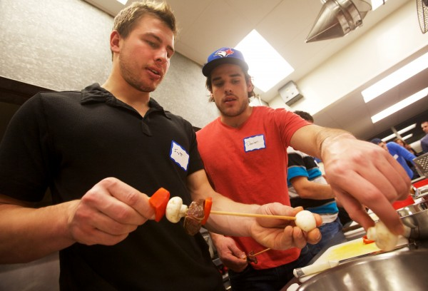 Portland Pirates hockey team members Scott Arnold (left) and Darian Dziurzynski put food on skewers while having a cooking lesson at Southern Maine Community College in South Portland on Tuesday, Nov. 27, 2012. About a dozen teammates took part in the four-hour course, learning to prepare a variety of healthy meals.