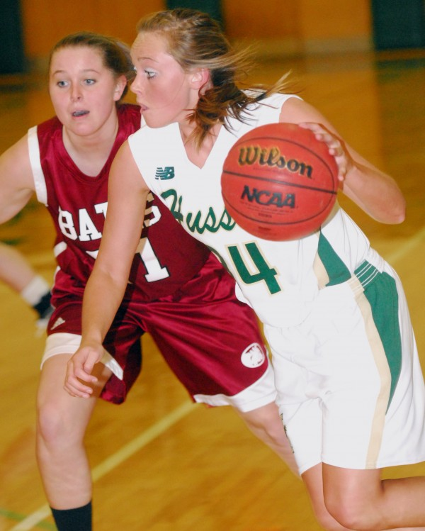 Husson University's Victoria McIntyre (34) drives past Bates' Hillary Throckmorton during second-half action at Husson's Newman Gym in Bangor on Tuesday night, Nov. 27, 2012. Bates won 88-43.