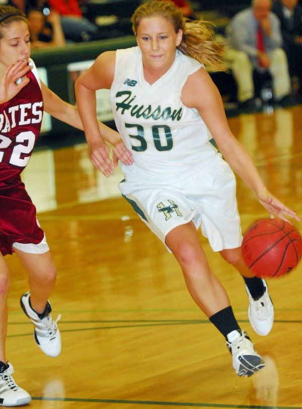 Husson University's Kelli Murray (30) goes to the basket while guarded by Bates' Allie Beaulieu during first-half action at Husson's Newman Gym in Bangor on Tuesday night, Nov. 27, 2012. Bates beat Husson 88-43.