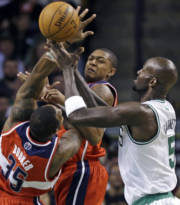 Washington Wizards forward Trevor Booker (35) and guard Bradley Beal, middle, vie for a loose ball with Boston Celtics forward Kevin Garnett (5) during the first half of an NBA basketball game in Boston on Wednesday, Nov. 7, 2012.