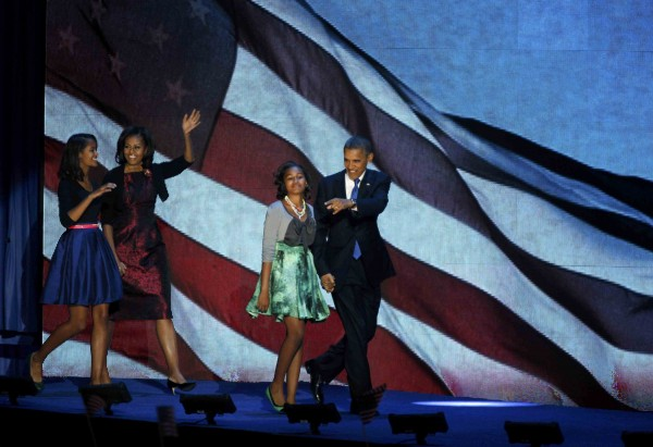 U.S. President Barack Obama, who won a second term in office by defeating Republican presidential nominee Mitt Romney, walks out with his family to address supporters during his election night rally in Chicago, Nov. 7, 2012.