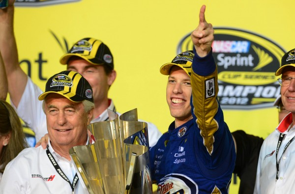 NASCAR Sprint Cup Series driver Brad Keselowski (right) and team owner Roger Penske celebrate after winning the 2012 championship following the Ford EcoBoost 400 at Homestead Miami Speedway on Nov. 18, 2012.