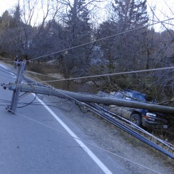Truck slams into pole in Topsham; power out, traffic slowed