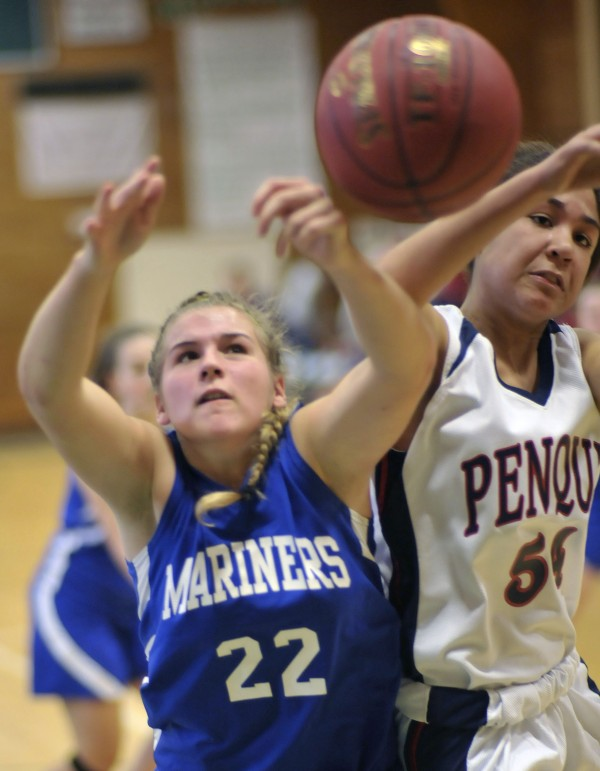 Deer Isle Stonington's Chelsea Brown (22) reaches for a rebound while colliding with Penquis' Hannah Bess during a preseason game last year. Brown will try to help lead DI-Stonington back to the tourney this season.