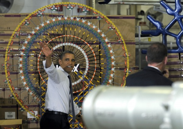 President Barack Obama waves after speaking at the Rodon Group, which manufactures over 95 percent of the parts for K'NEX Brands toys, Friday, Nov. 30, 2012, in Hatfield, Pa. The visit comes as the White House continues a week of public outreach efforts, while also attempting to negotiate a deal with congressional leaders.