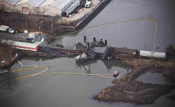 Derailed freight train cars sit semi-submerged in the waters of Mantua Creek after a train crash in Paulsboro, New Jersey, Nov. 30, 2012. A rail bridge collapsed on Friday over a creek in southern New Jersey, causing a Conrail freight train to derail and spill hazardous chemicals into the air and water, authorities said.