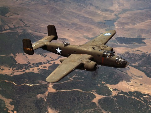 "Walter Cummings remembers a B-25 Mitchell nicknamed the ""Outhouse Mouse/"" The bomber was similar to this one flying over California."