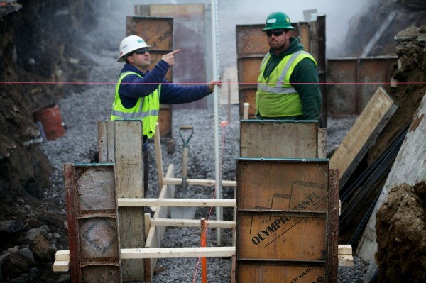 Foreman Daniel Deschenes (left) and carpenter Timber Patrick work at a Newman Concrete Services job site in Portland Tuesday Nov. 27, 2012. Their boss, F. Douglas Newman, is worried about what the Affordable Care Act might mean for small-scale employers like him.