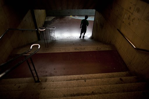 A man enters to an empty subway station during a nationwide 24-hour general strike in Buenos Aires, Argentina on Tuesday, Nov. 20, 2012. Argentine President Cristina Fernandez is facing a nationwide strike, led by union bosses who once were her most steadfast supporters. Many trains and bus lines are paralyzed; banks, courts and schools are closed; airlines have canceled flights and small groups of people have blocked highways in about a dozen places around the capital.