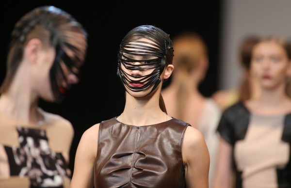 Models present a creation by Belarus designer Natasha Tsuran during Belarus Fashion Week in Minsk, Sunday, Nov. 4, 2012.