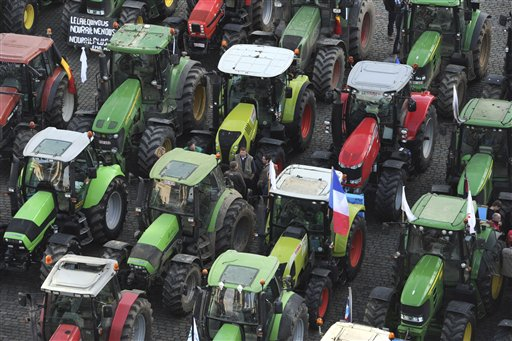 European milk farmers park their tractors before driving into the European quarter in Brussels, Monday, Nov. 26, 2012. Farmers drove their tractors into Brussels for a two-day demonstration on Monday to protest against what they believe are unfair milk prices.