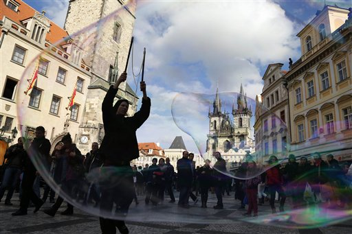 A street artist performs with bubbles at the Old Town Square in Prague, Czech Republic on Friday, Nov. 2, 2012.