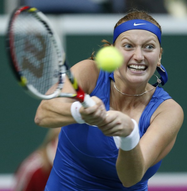 Czech Republic's Petra Kvitova returns a ball to Jelena Jankovic from Serbia during the Fed Cup  final tennis  match in Prague, Czech Republic, Saturday, Nov. 3, 2012.