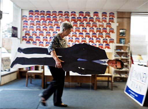 Volunteer Clare Frew puts away a life-size cutout of presidential hopeful Mitt Romney as she prepares to close the Chatham County Republican Campaign office, Tuesday, Nov. 6, 2012, in Savannah, Ga.  After a grinding presidential campaign, Americans are heading  into polling places across the country.