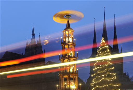 A lengthy time-exposure photo was made of the  traditional Christmas Fair during heavy rain in front of the Mariendom, or Cathedral of Mary, (left) and St. Severi's Church in Erfurt, central Germany on Wednesday, Nov. 28, 2012. The Erfurt Christmas Market is one of the most beautiful Christmas Markets in Germany. The square is beautifully decorated with a huge, candle-lit Christmas tree and a large, hand-carved wooden nativity scene.