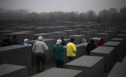 People enter the Holocaust Memorial in Berlin on Thursday, Nov. 15, 2012. Sixty years after a landmark accord started German government compensation for victims of Nazi crimes, fund administrators and German officials say payments to Holocaust survivors are needed more than ever as they enter their final years. In acknowledgement of that, German Finance Minister Wolfgang Schaeuble was to sign off officially Thursday on revisions to the original 1952 compensation treaty, increasing pensions for those living in eastern Europe and broadening who is eligible for payments.
