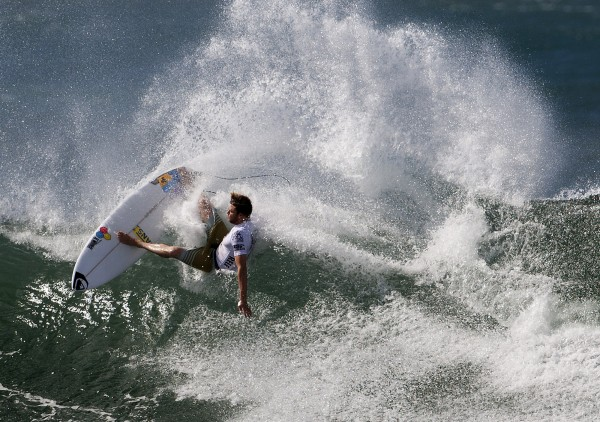 In this photo provided by the Association of Surfing Professionals, Dane Reynolds of Venture, Calif., cuts back on a wave during the Reef Hawaiian Pro surfing competition at Ali'i Beach Park in Haleiwa, Hawaii, Friday, Nov. 16, 2012.