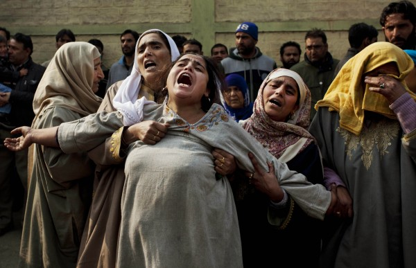 Kashmiri Muslim women comfort a wailing relative of Mushtaq Ahmed during his funeral procession in Srinagar, India, Friday, Nov. 16, 2012. Unidentified gunmen Thursday opened fire at a liquor shop on the banks of Dal Lake killing Ahmed and injuring four more, police said.