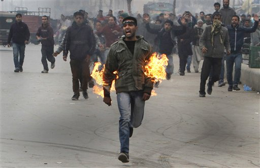 A Kashmiri Shiite mourner runs after he set himself on fire during a Muharram procession in Srinagar, India on Friday, Nov. 23, 2012. The Kashmiri man was protesting a police ban on religious processions marking the Muslim month of Muharram in Indian-controlled Kashmir's main city. Police said that clashes erupted when troops tried to stop groups of Shiite Muslims from gathering.