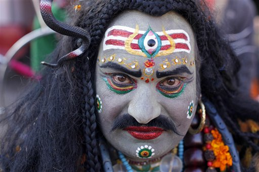 An Indian man, dressed as Hindu God Lord Shiva, participates in a procession during the annual cattle fair in Pushkar, Rajasthan, India on Saturday, Nov. 24, 2012.  Pushkar, located on the banks of Pushkar Lake, is a popular Hindu pilgrimage spot that is also frequented by foreign tourists who come to the town for the annual cattle fair and camel races.