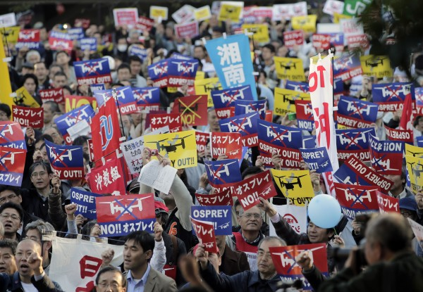 Protesters stage a rally against the deployment of US Marine Corps' MV-22 Osprey in Okinawa, at a park in Tokyo, Sunday, Nov. 4, 2012. Many Okinawans believe the aircraft isn't safe to operate over their crowded cities.