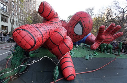 Workers inflate the Spider-Man balloon for the 86th annual Macy's Thanksgiving Day Parade, on New York's Upper West Side on  Wednesday, Nov. 21, 2012. More than 3 million people typically attend the event and it has a television audience of 50 million.