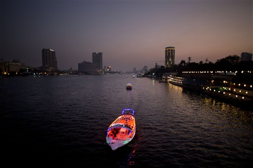 Boats travel on the Nile River in Cairo, Egypt on Wednesday, Nov. 7, 2012.
